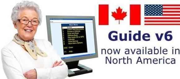 "A picture of a lady standing in front of a computer monitor showing Dolphin Guide, with the Canada and US flags above text that states ""Guide v6 now available in North America""."