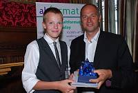 Photo of Oscar Marshall receiving his AltFormat trophy from Sir Steve Redgrave