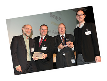 Photo of Huw Alexander of Sage receiving the Publisher Lookup award for library services. Award presented by Peter Griffiths, former head of CILIP, Steve Palmer, CEO at Dolphin Computer Access Ltd, and Ian Litterick Executive Chairman at iansyst Ltd.