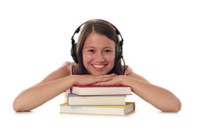 Image of a girl wearing headphones leaning on a small pile of books