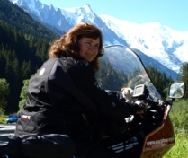 Picture of Catherine on the motorbike in the Swiss Alps