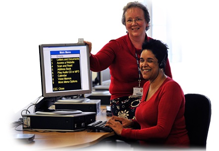 Photo of Lisa and her tutor Jo sitting in the computer room at Dudley College