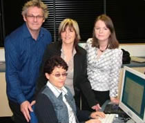 Photo of the students at the Newry Institute testing Dolphin software on a PC.