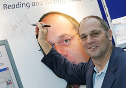 Photo of Sir Steve Redgrave signing the poster on the Dolphin stand at Bett 2007