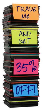 A pile of floppy disks with post-its that read Trade-me and get 35% off.